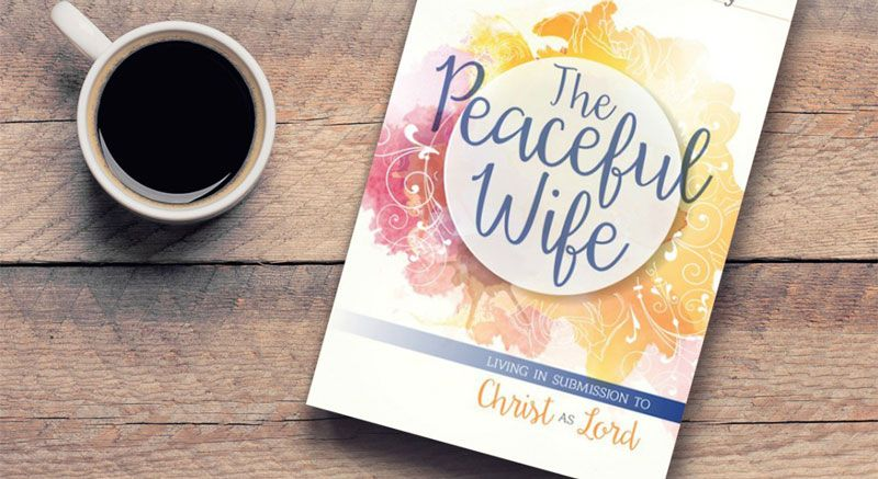 Picture of the Peaceful Wife book and a cup of coffee on a wooden table