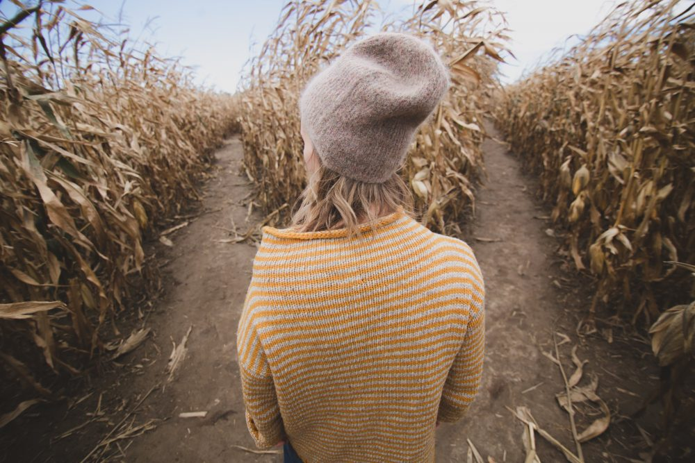 woman in a corn maze