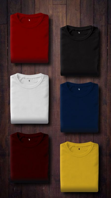 solid colored t-shirts folded and lined up in two rows